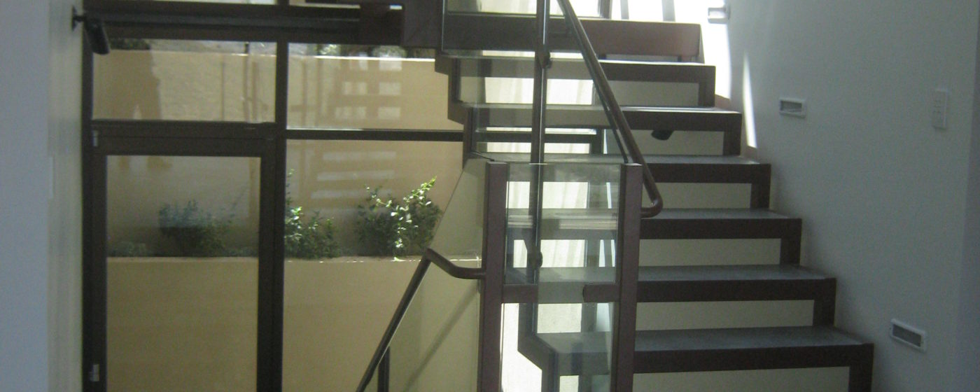 Floating Steel Stairway with Concrete Steps and Glass Railing