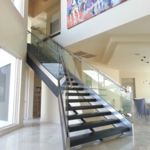 Glass in U-Chanel Curbwall W. Brushed Stainless Rail & Cladding