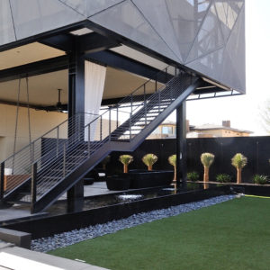 Steel Freestanding Stairway with C Channel Stringers and Bar Grating Steps and Risers and Stainless Steel Cable Railing