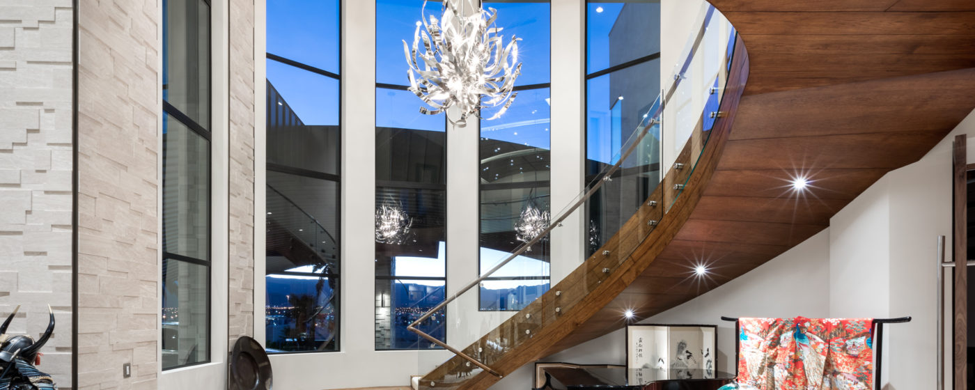 Wood wrapped curved freestanding stairway